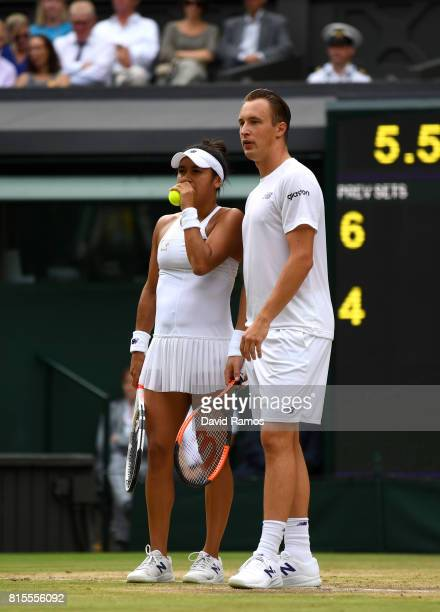 Heather Watson of Great Britain and Henri Kontinen of Finland in discussion during the Mixed Doubles final match against Jamie Murray of Great...