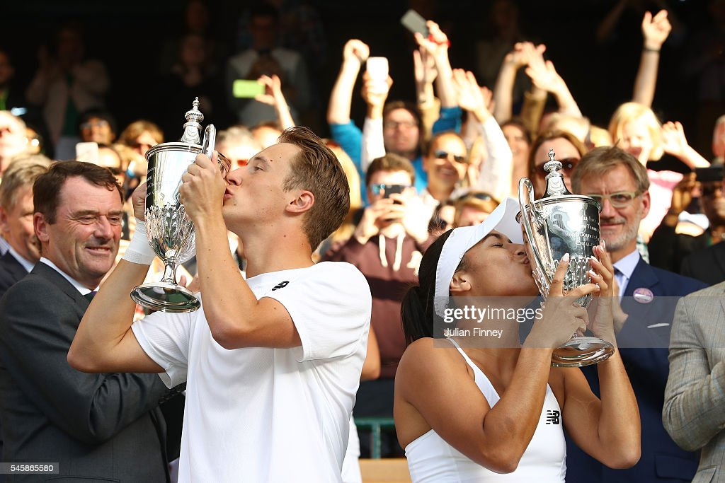 Heather Watson of Great Britain and Henri Kontinen of Finland kiss their trophies following victory in the Mixed Doubles Final against Robert Farah of Columbia and Anna-Lena Groenefeld of Germany on day thirteen of the Wimbledon Lawn Tennis Championships at the All England Lawn Tennis and Croquet Club on July 10, 2016 in London, England.