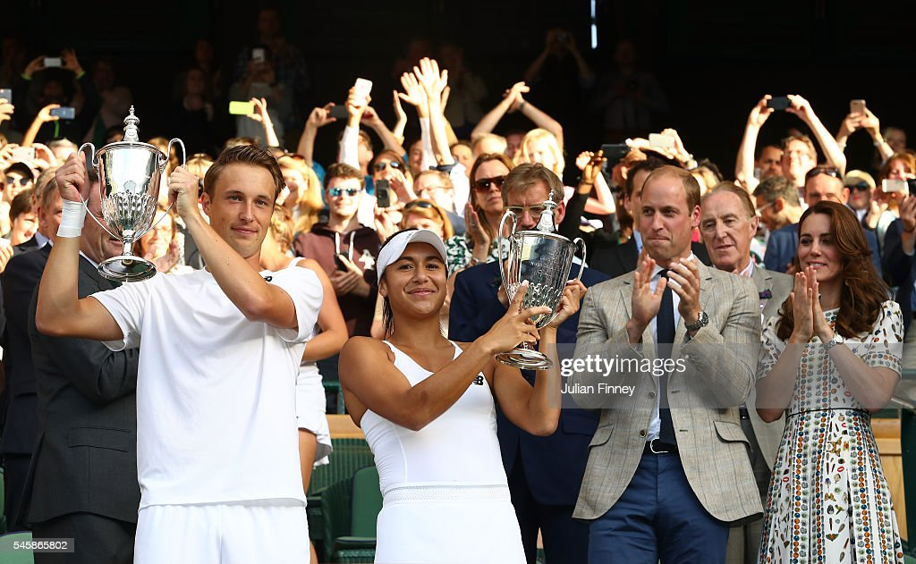 Heather Watson of Great Britain and Henri Kontinen of Finland lift their trophies as Prince William, HRH The Duke of Cambridge and Catherine, HRH The Duchess of Cambridge watch on following their victory in the Mixed Doubles Final against Robert Farah of Columbia and Anna-Lena Groenefeld of Germany on day thirteen of the Wimbledon Lawn Tennis Championships at the All England Lawn Tennis and Croquet Club on July 10, 2016 in London, England.