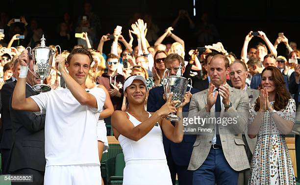 Heather Watson of Great Britain and Henri Kontinen of Finland lift their trophies as Prince William HRH The Duke of Cambridge and Catherine HRH The...