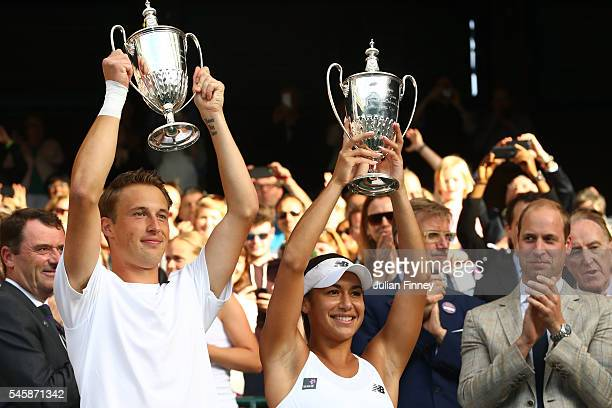 Heather Watson of Great Britain and Henri Kontinen of Finland lift their trophies following victory in the Mixed Doubles Final against Robert Farah...