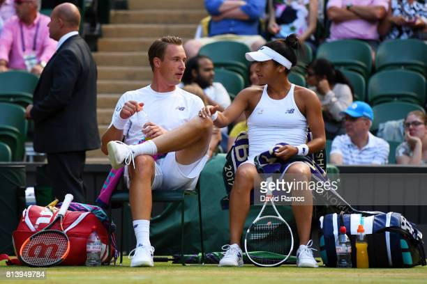 Heather Watson of Great Britain and Henri Kontinen of Finland talk in the Mixed Doubles quarter final match against Rohan Bopanna of India and...