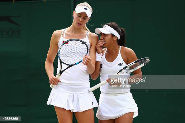 Heather Watson of Great Britain and Naomi Broady of Great Britain in conversation during the Ladies doubles first round match against Cagla...