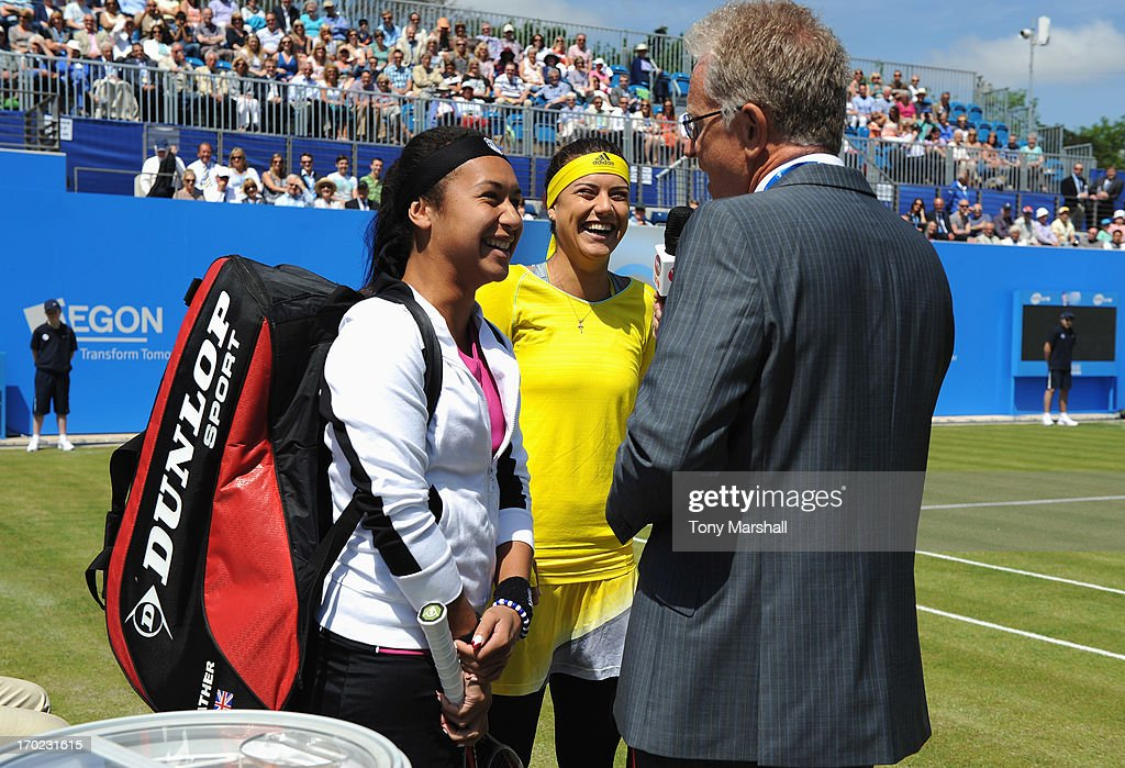 Heather Watson of Great Britain and Sorana Cirstea of Romania talk to Mark Curry prior to their mixed doubles exhibition match with respective partners Tim Henman and Greg Rusedski of Great Britain during day one of the AEGON Classic tennis tournament at Edgbaston Priory Club on June 9, 2013 in Birmingham, England.