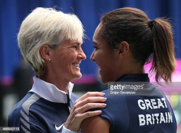 Heather Watson of Great Britain celebrate victory with team captain Judy Murray against Jelena Ostapenko of Latvia during the day one Fed Cup Fed Cup...