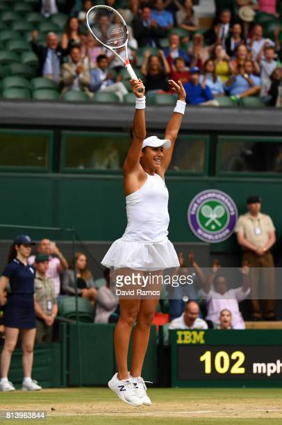 Heather Watson of Great Britain celebrates match point and victory after the Mixed Doubles quarter final match against Rohan Bopanna of India and...