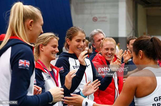 Heather Watson of Great Britain celebrates with Johanna Konta Anna Smith and Jocelyn Rae of Great Britain after defeating Elina Svitolina of Ukraine...