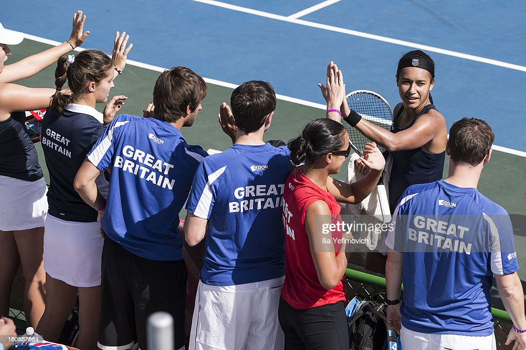 Heather Watson of Great Britain celebrates with team members after a match against Anita Husaric of Bosnia and Herzegovina during the tie between Great Britain and Bosnia and Herzegovina during the Fed Cup Europe/Africa Group One fixture at the Municipal Tennis Club on February 7, 2013 in Eilat, Israel.