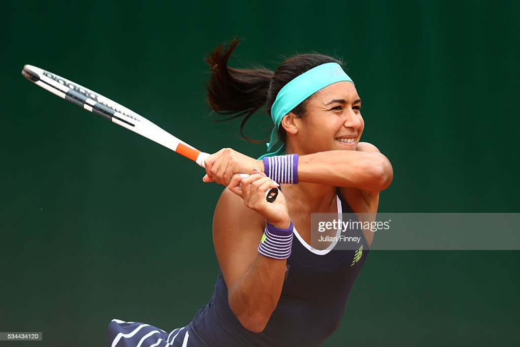 Heather Watson of Great Britain hits a backhand during the Ladies Doubles first round match against Sabine Lisicki and Andrea Petkovic of Germany on day five of the 2016 French Open at Roland Garros on May 26, 2016 in Paris, France.