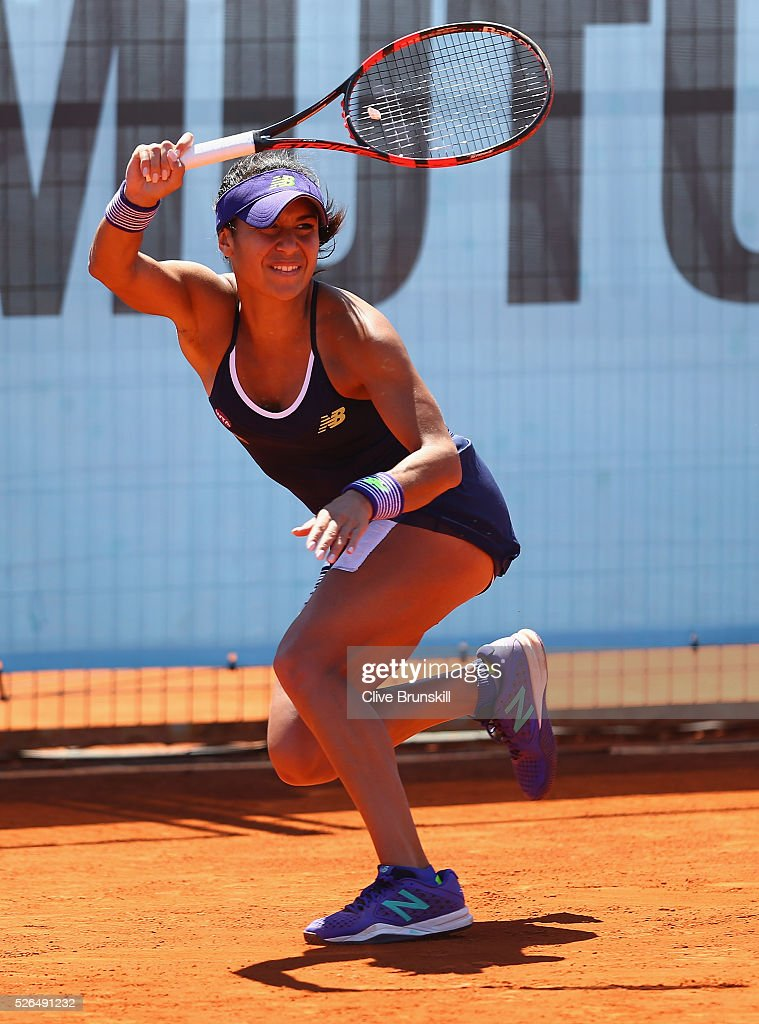 Heather Watson of Great Britain in action against Mirjana Lucic-Baroni of Croatia in their second round qualifying match during day one of the Mutua Madrid Open tennis tournament at the Caja Magica on April 30, 2016 in Madrid, Spain. .