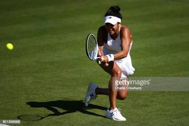 Heather Watson of Great Britain in action during her first round match against Dominika Cibulkova of Slovakia during day two of the Aegon...