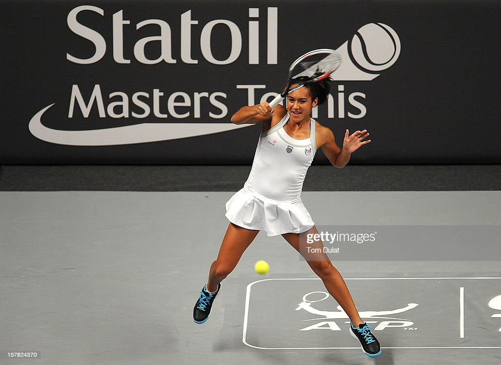 <a gi-track='captionPersonalityLinkClicked' href=/galleries/search?phrase=Heather+Watson&family=editorial&specificpeople=5418928 ng-click='$event.stopPropagation()'>Heather Watson</a> of Great Britain in action during match against Mark Philippoussis of Australia and Anne Keothavong of Great Britain on Day Two of the Statoil Masters Tennis at the Royal Albert Hall on December 6, 2012 in London, England.