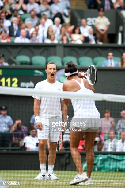 Heather Watson of Great Britain in action with Henri Kontinen of Finland in the Mixed Doubles Final on Center Court during the Wimbledon Lawn Tennis...