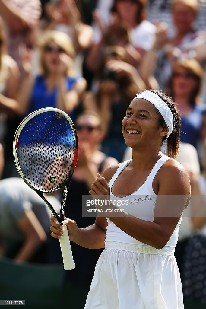 Heather Watson of Great Britain is all smiles after winning her Ladies' Singles first round match against against Ajla Tomljanovic of Croatia on day two of the Wimbledon Lawn Tennis Championships at the All England Lawn Tennis and Croquet Club at Wimbledon on June 24, 2014 in London, England.
