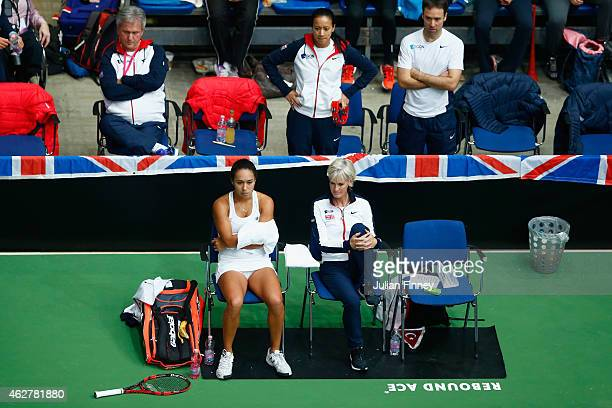 Heather Watson of Great Britain looks on with Captain Judy Murray in the match against Cagla Buyukakcay of Turkey during day two of the Fed...