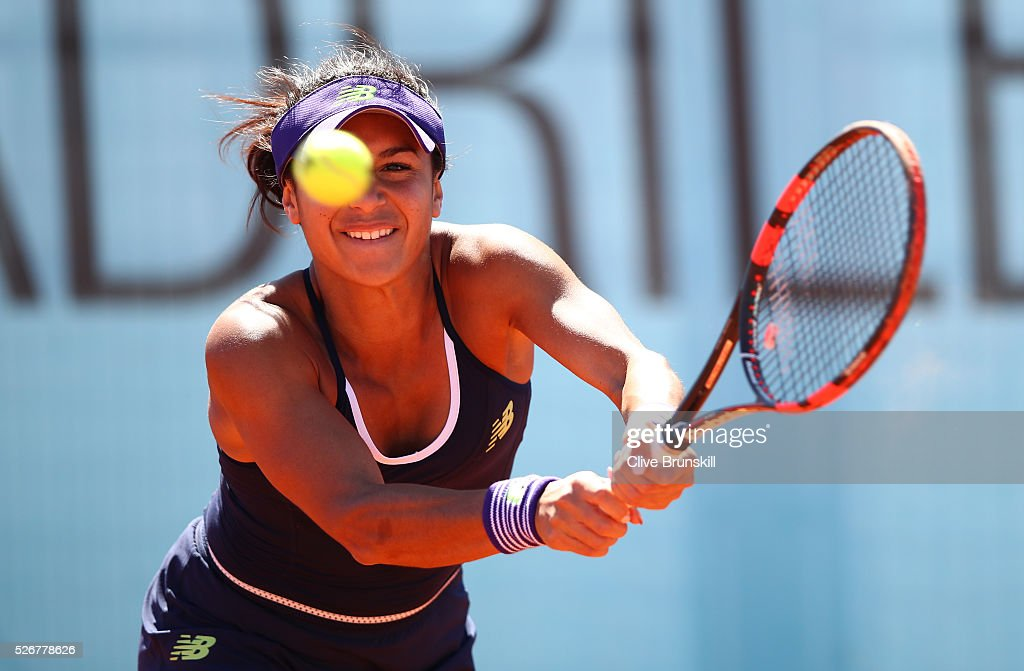 Heather Watson of Great Britain plays a backhand against Daria Gavrilova of Australia in their first round match during day two of the Mutua Madrid Open tennis tournament at the Caja Magica on May 01, 2016 in Madrid,Spain