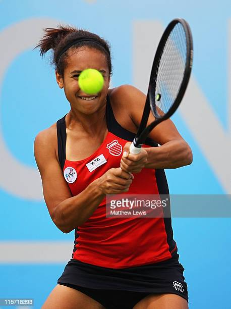 Heather Watson of Great Britain plays a backhand during her match against Shuai Peng of China during the fourth day of the AEGON Classic at the...