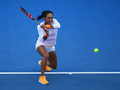 Heather Watson of Great Britain plays a backhand in the women's single's match against Teliana Pereira of Brazil during day two of the 2016 Hobart...