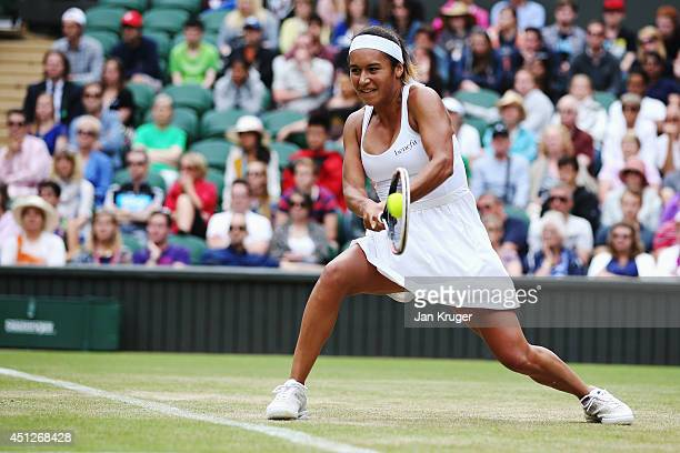 Heather Watson of Great Britain plays a backhand return during her Ladies' Singles second round match against Angelique Kerber of Germany on day four...