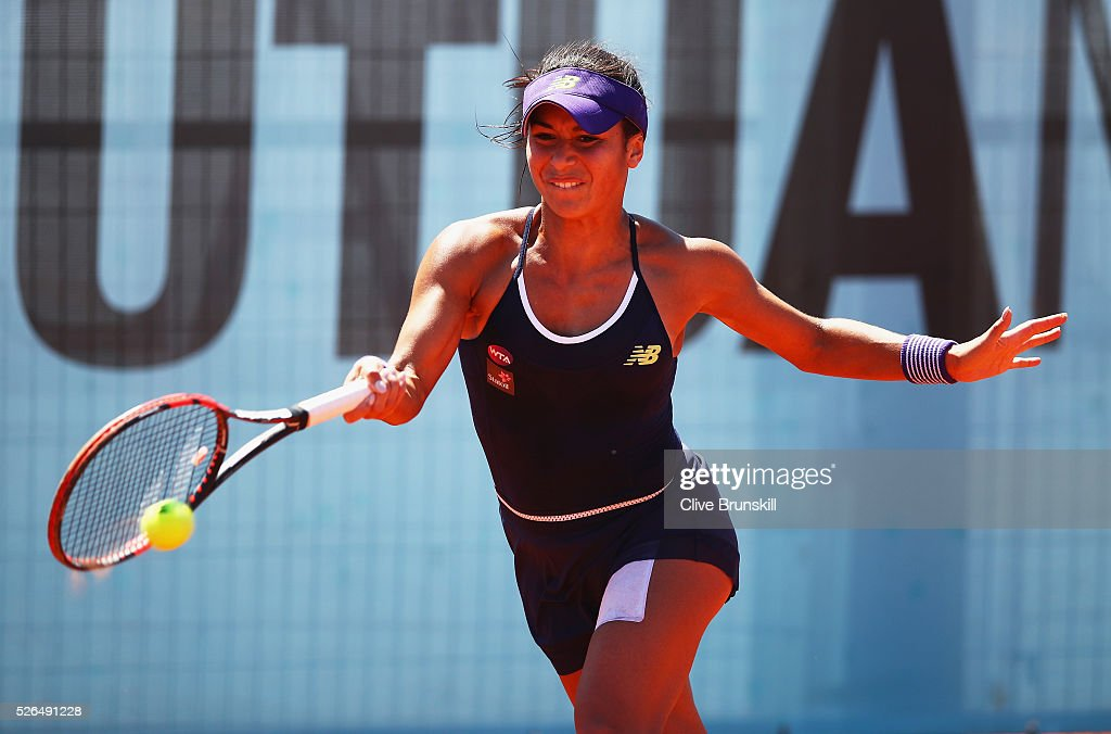 Heather Watson of Great Britain plays a forehand against Mirjana Lucic-Baroni of Croatia in their second round qualifying match during day one of the Mutua Madrid Open tennis tournament at the Caja Magica on April 30, 2016 in Madrid, Spain. .