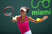 Heather Watson of Great Britain plays a forehand against Yanina Wickmayer of Belgium in their third round match during the Miami Open Presented by...