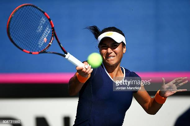 Heather Watson of Great Britain plays a forehand during her match against Alison van Uytvanck of Belgium during the tie between Belgium and Great...
