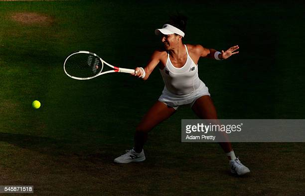 Heather Watson of Great Britain plays a forehand during the Mixed Doubles Final against Robert Farah of Columbia and AnnaLena Groenfeld of Germany on...