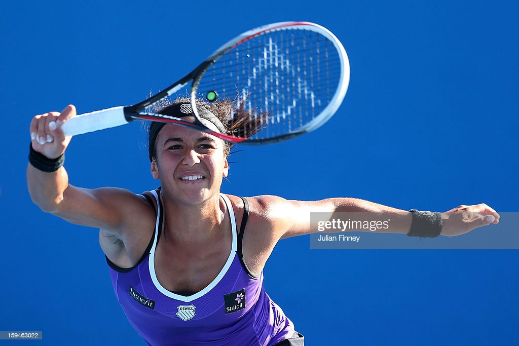 Heather Watson of Great Britain plays a forehand in her first round match against Alexandra Cadantu of Romania during day one of the 2013 Australian Open at Melbourne Park on January 14, 2013 in Melbourne, Australia.