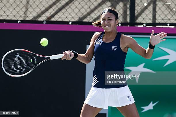 Heather Watson of Great Britain plays a shot in her match against Anita Husaric of Bosnia and Herzegovina during the tie between Great Britain and...