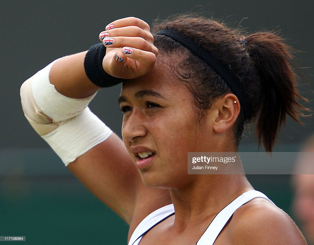 <a gi-track='captionPersonalityLinkClicked' href=/galleries/search?phrase=Heather+Watson&family=editorial&specificpeople=5418928 ng-click='$event.stopPropagation()'>Heather Watson</a> of Great Britain reacts to a play during her first round match against Mathilde Johansson of France on Day Three of the Wimbledon Lawn Tennis Championships at the All England Lawn Tennis and Croquet Club on June 22, 2011 in London, England.