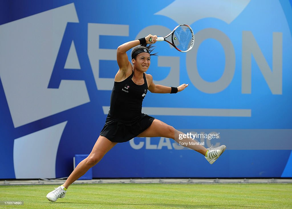 <a gi-track='captionPersonalityLinkClicked' href=/galleries/search?phrase=Heather+Watson&family=editorial&specificpeople=5418928 ng-click='$event.stopPropagation()'>Heather Watson</a> of Great Britain returns a shot against Alla Kudryavtseva of Russia during the AEGON Classic Tennis Tournament at Edgbaston Priory Club on June 12, 2013 in Birmingham, England.