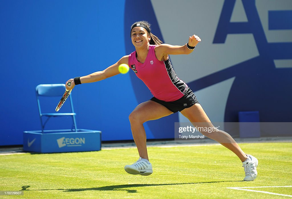 <a gi-track='captionPersonalityLinkClicked' href=/galleries/search?phrase=Heather+Watson&family=editorial&specificpeople=5418928 ng-click='$event.stopPropagation()'>Heather Watson</a> of Great Britain returns in her mixed doubles exhibition match partnering Tim Henman against Greg Rusedski and Sorana Cirstea of Romania during day one of the AEGON Classic tennis tournament at Edgbaston Priory Club on June 9, 2013 in Birmingham, England.