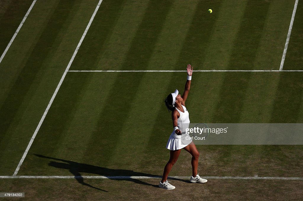 Heather Watson of Great Britain serves against Daniela Hantuchova of Slovakia in their Ladies Singles Second Round match during day three of the Wimbledon Lawn Tennis Championships at the All England Lawn Tennis and Croquet Club on July 1, 2015 in London, England.