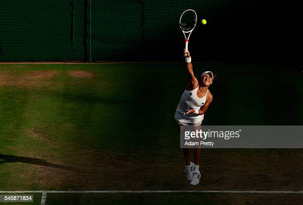 Heather Watson of Great Britain serves during the Mixed Doubles Final against Robert Farah of Columbia and AnnaLena Groenfeld of Germany on day...