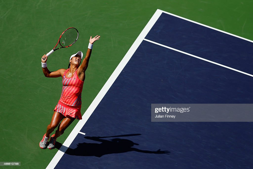 Heather Watson of Great Britain serves to Carla Suarez Navarro of Spain during day nine of the BNP Paribas Open tennis at the Indian Wells Tennis Garden on March 17, 2015 in Indian Wells, California.