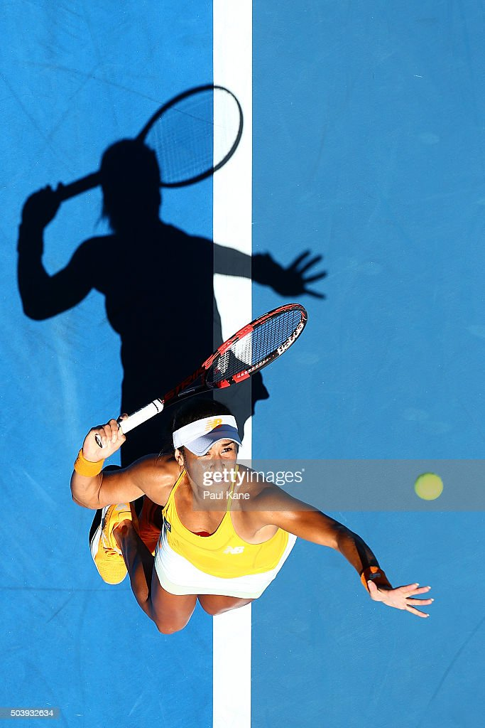 Heather Watson of Great Britain serves to Sabine Lisicki of Germany in the womens singles match during day six of the 2016 Hopman Cup at Perth Arena on January 8, 2016 in Perth, Australia.