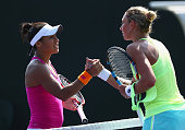 Heather Watson of Great Britain shakes hands at the net after her three set victory against Yanina Wickmayer of Belgium in their third round match...