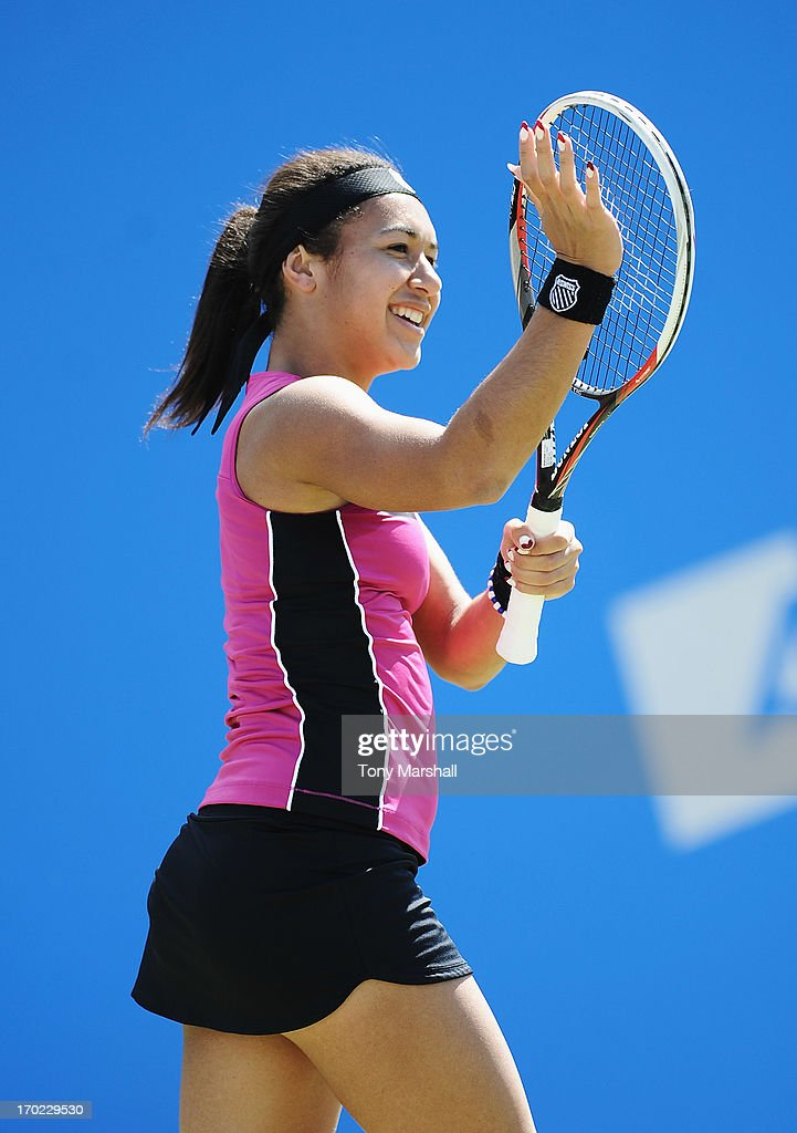Heather Watson of Great Britain smiles in her mixed doubles exhibition match partnering Tim Henman against Greg Rusedski and Sorana Cirstea of Romania during day one of the AEGON Classic tennis tournament at Edgbaston Priory Club on June 9, 2013 in Birmingham, England.