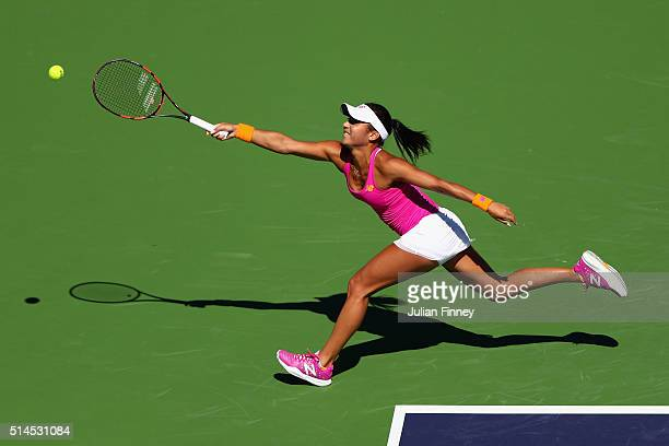 Heather Watson of Great Britain stretches for a forehand in her match against Galina Voskoboeva of Kazakhstan during day three of the BNP Paribas...