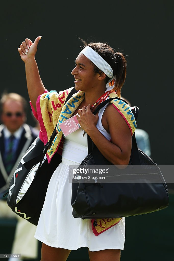 Heather Watson of Great Britain walks of all smiles after winning her Ladies' Singles first round match against against Ajla Tomljanovic of Croatia on day two of the Wimbledon Lawn Tennis Championships at the All England Lawn Tennis and Croquet Club at Wimbledon on June 24, 2014 in London, England.