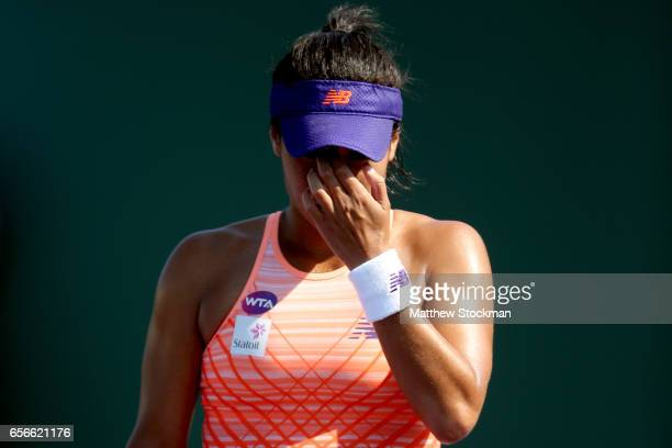 Heather Watson of Great Britain walks to the net after losing to Patricia Maria Tig of Romania during the Miami Open at the Crandon Park Tennis...