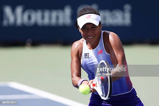 Heather Watson of the United Kingdom returns a shot to Richel Hogenkamp of the Netherlands during her first round Women's Singles match on Day Two of...