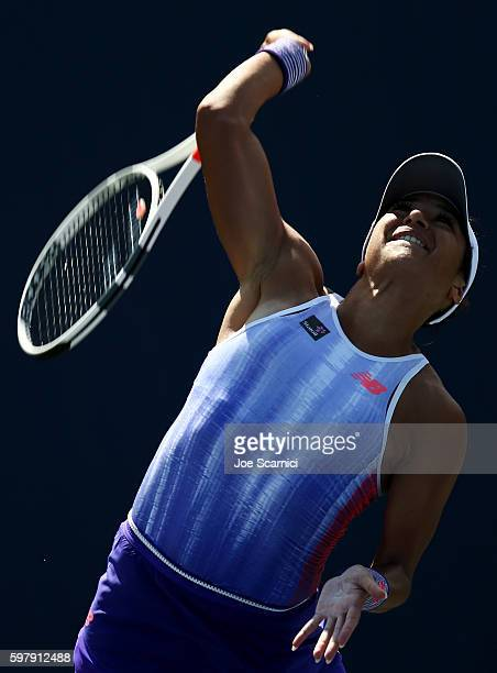 Heather Watson of the United Kingdom serves to Richel Hogenkamp of the Netherlands during her first round Women's Singles match on Day Two of the...
