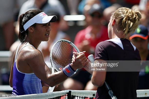 Heather Watson of the United Kingdom shakes hands with Richel Hogenkamp of the Netherlands after their first round Women's Singles match on Day Two...