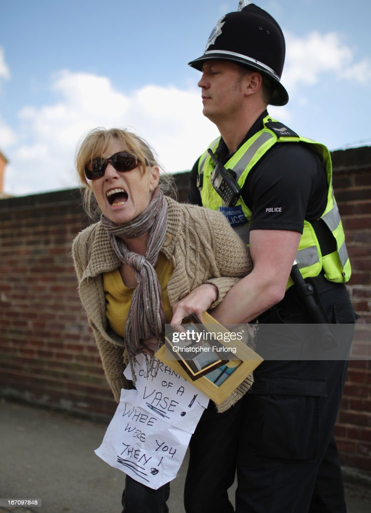 Heather Wilhelms, whose husband Tom Wilhelms died in Stafford Hospital, is restrained by a police officer as thousands of campaigners take to the streets of Stafford to keep major health services at the scandal hit Hospital on April 20, 2013 in Stafford, England. The march was organised by the Support Stafford Hospital campaign group who are fighting cuts to major health services at the hospital. The Health regulator Monitor has appointed two special administrators to produce a plan for the reorganisation of future services.