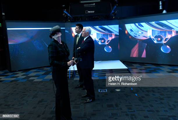 LITTLETON CO OCTOBER 26 Heather Wilson Secretary of the Air Force left uses VR glasses inside Collaborative Human Immersive Laboratory or CHIL...
