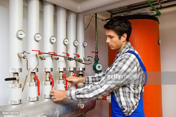 heating engineer checking a heating system