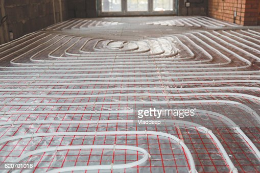 Heating posed in a under construction building : Foto de stock