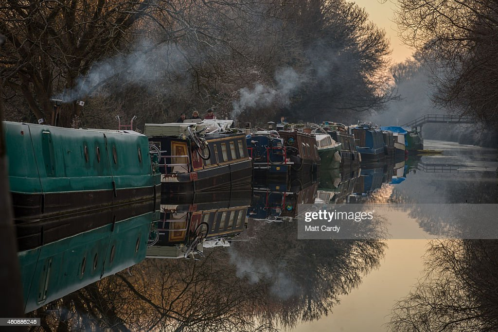 Heating smoke rises from narrowboats moored on the canal near Bathampton on December 29, 2014 in Bath and North East Somerset, England. According to the Met Office Britain experienced the coldest night of the year overnight, with some areas being even colder than Alaska and the Antarctica and as forecasters believe it could get even colder tonight, a Met Office cold weather alert for northern England and the Midlands has warned of health risks for vulnerable people.