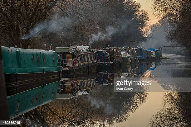 Heating smoke rises from narrowboats moored on the canal near Bathampton on December 29 2014 in Bath and North East Somerset England According to the...